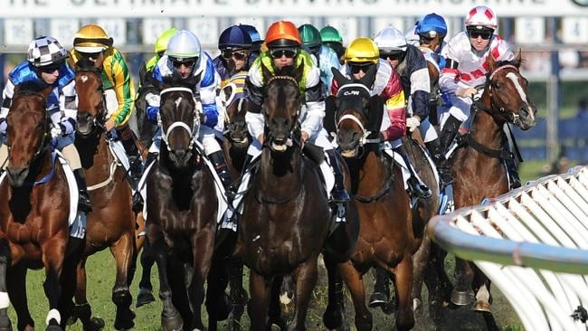 Tommy Berry (right) suffers interference on Glencadam Gold in the first lap of the Caulfield Cup. Picture: Getty Images