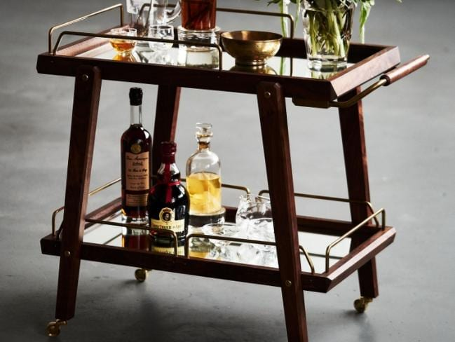 A bar cart that costs a whopping $13,800 is an indulgent way to display your booze. Picture: Goop