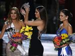 Former Miss Universe Paulina Vega, removes the crown from Miss Colombia Ariadna Gutierrez, before giving it to Miss Philippines Pia Alonzo Wurtzbach at the Miss Universe Pageant. Picture: AP