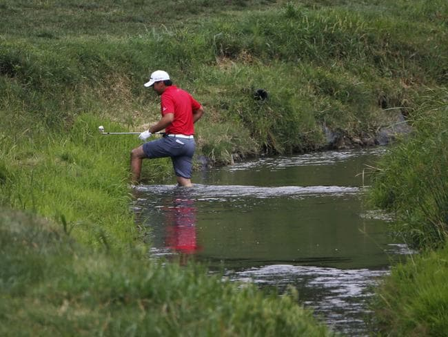 Jason Day crosses water on the second hole.