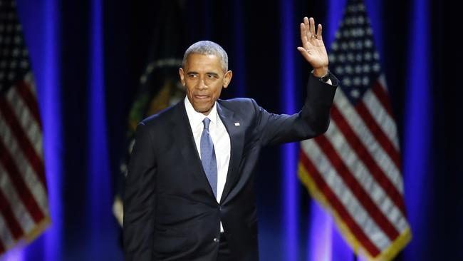 President Barack Obama silences the crowd during his last speech. Picture: AP Photo/Charles Rex Arbogast