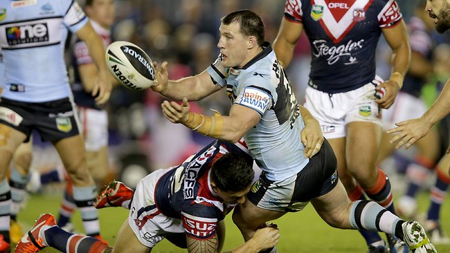 Shark's Paul Gallen offloads as he is tackled by Sonny Bill Williams during the Cronulla Sharks vs Sydney Roosters game at Remondis Stadium, Cronulla. Picture: Gregg Porteous