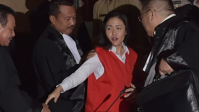 Indonesian suspect Jessica Kumala Wongso is guarded by her lawyers after her trial at the Central Jakarta court in Jakarta on June 15, 2016. Picture: AFP