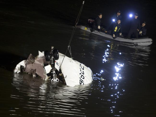 Rescuers light up the the wreckage of the TransAsia ATR 72-600 on the Keelung river at New Taipei City on February 4. Picture: Ashley Pon