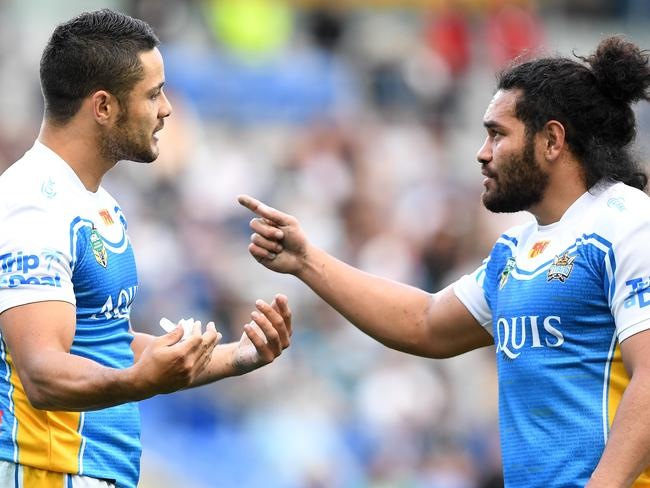 Titans player Jarryd Hayne and Konrad Hurrell discuss a crucial point.