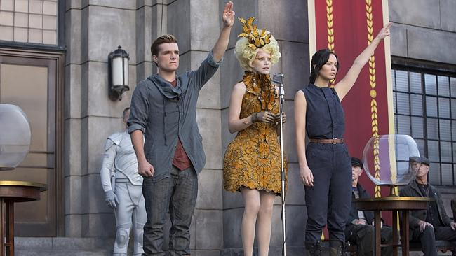 "On fire ... Josh Hutcherson as Peeta Mellark, from left, Elizabeth Banks as Effie Trinket and Jennifer Lawrence as Katniss Everdeen in a scene from ""The Hunger Games: Catching Fire."" Picture: AP Photo/Lionsgate, Murray Close"