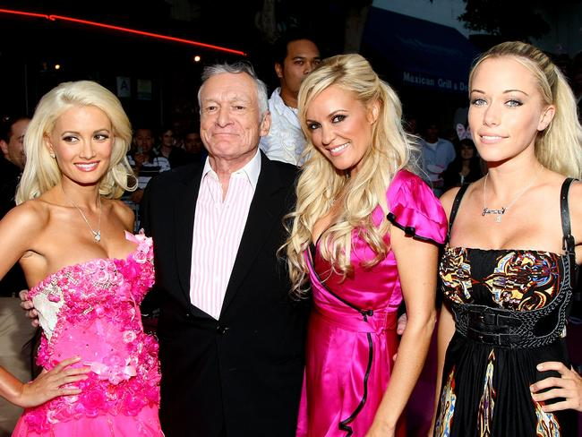 Former Playboy Playmates Holly Madison, Bridget Marquardt and Kendra Wilkinson with Hefner in 2008. Picture: Alberto E. Rodriguez/Getty Images