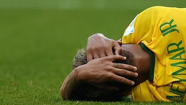 Brazil's forward Neymar reacts after falling during the round of 16 match against Chile.