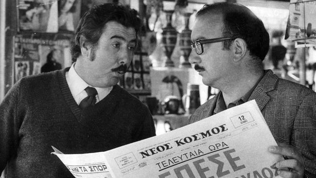 Two men reading Greek-language newspaper Neos Kosmos in the 1970s.