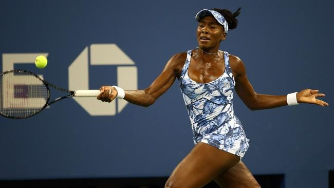 Venus Williams returns a shot against Timea Bacsinszky of Switzerland during their women's singles second round match at the US Open yesterday. Photo: Streeter Lecka.