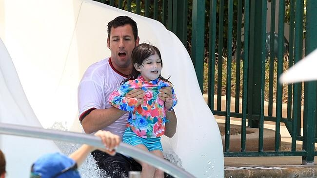 Talk about a big kid! Adam Sandler seems to be having more fun than his daughter. Picture: Splash News