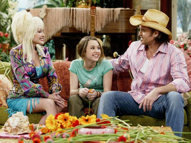 Country music royalty ... Dolly Parton with Billy Ray Cyrus and Miley Cyrus in a scene from 'Hannah Montana'. Picture: Supplied