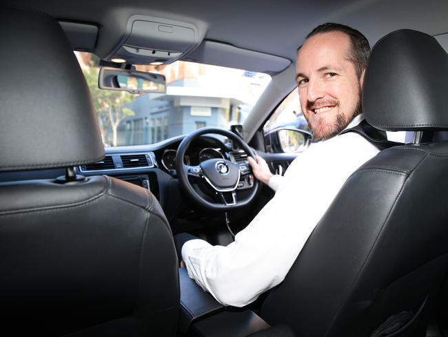 Uber driver Clint Thomas will now be able to drive passengers legally but will have to pay a licence fee and undergo criminal checks and regularly get his car checked.