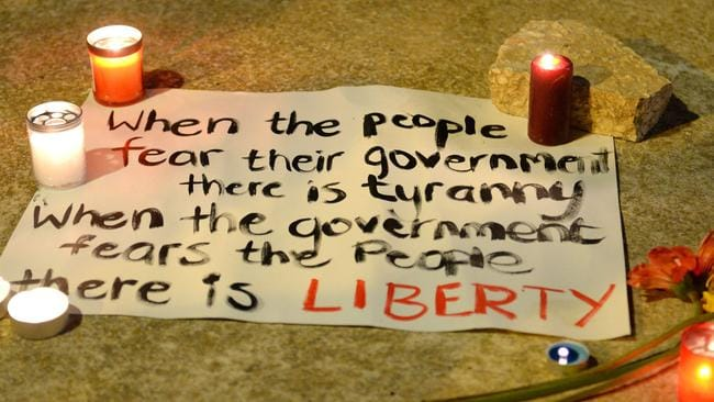 A message is seen on the pavement as thousands of people gather for a candlelight vigil in Sliema, in tribute to late journalist Daphne Caruana Galizia who was killed by a car bomb close to her home in Bidnija, Malta. Picture: AFP / Matthew Mirabelli