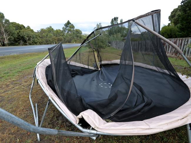 A mangled trampoline dragged off the Southern Outlet near Kingston after being blown out of a nearby back yard during wild weather earlier this year. Picture: PATRICK GEE