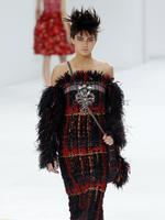 Kendall Jenner presents a creation for the Chanel show as part of Paris Fashion Week - Haute Couture Fall/Winter 2014 in Paris, France. Picture: AFP