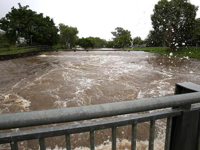 Parts of Brisbane were flooded hours ahead of the storm's peak. Blunder Rd Causeway at Durack Picture: Marc Robertson
