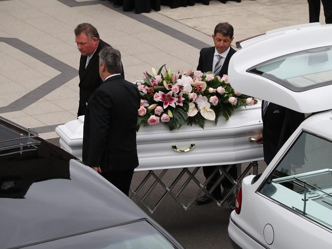 Annabelle's coffin is carried into the church. Picture: David Swift.