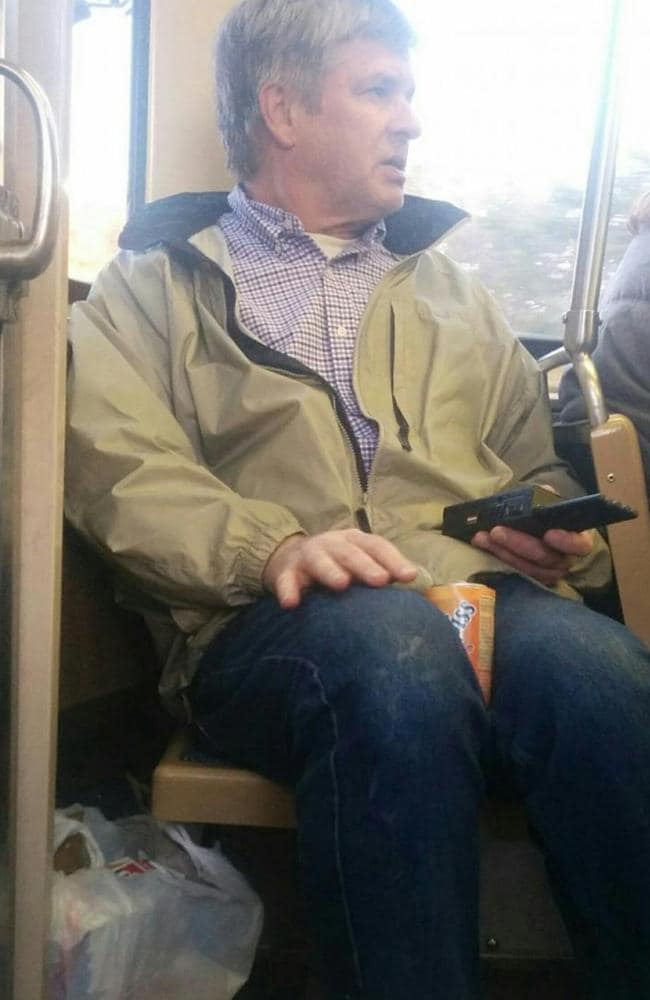 Dennis Nicholl uses a cell phone silencer on the train. Picture: Reddit