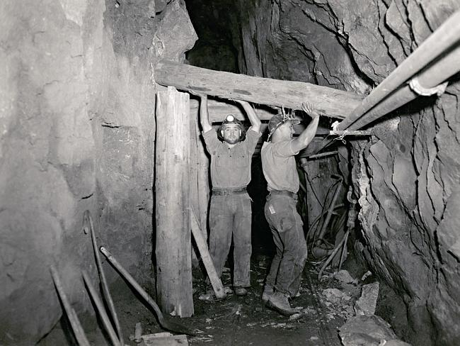 Two miners secure a passage at 400ft in the uranium mine at Radium Hill in SA in 1957. Picture: Cliff Bottomley