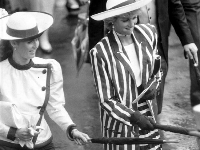 Princess Diana and Sarah Ferguson used to be quit the naughty pair. Here they are pictured jabbing Hugh Lindsay with their umbrellas in 1987.