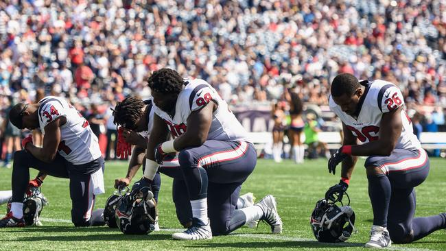 Houston Texans players kneeling today. Pic: AFP