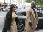 Uber stylishly co-ordinated Kim Kardashian and Kanye West arrive at a luxury shop in Paris, Wednesday, May 21, 2014. Picture: AFP