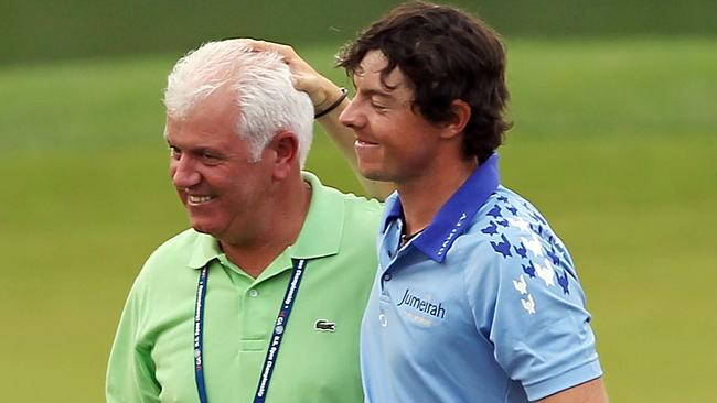 Rory McIlroy celebrates his eight-stroke US Open victory with his father Gerry in 2011.
