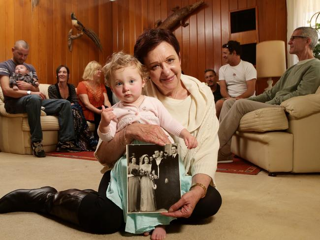 FAMILY: Sue Struenkmann with granddaughter Bella and other family at her Somerton Park house. Picture: Calum Robertson