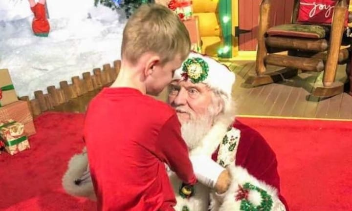 Heartwarming moment a blind, autistic boy meets Santa