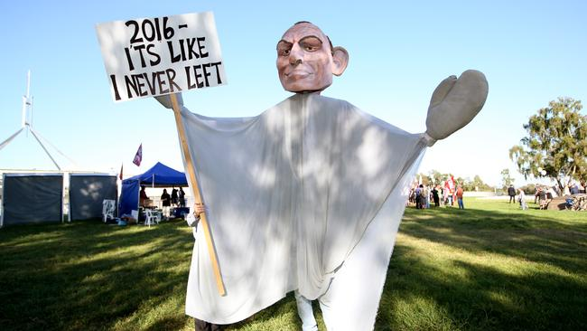 A protester at a rally against the CSIRO job cuts outside Parliament House. Picture: Kym Smith