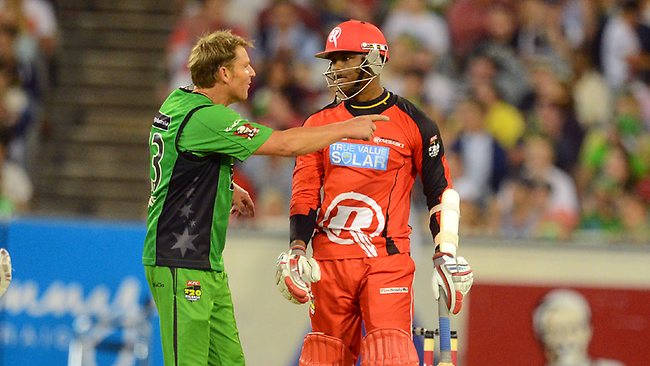 Shane Warne and Marlon Samuels in a heated exchange at the MCG last night. Picture: Wayne Ludbey