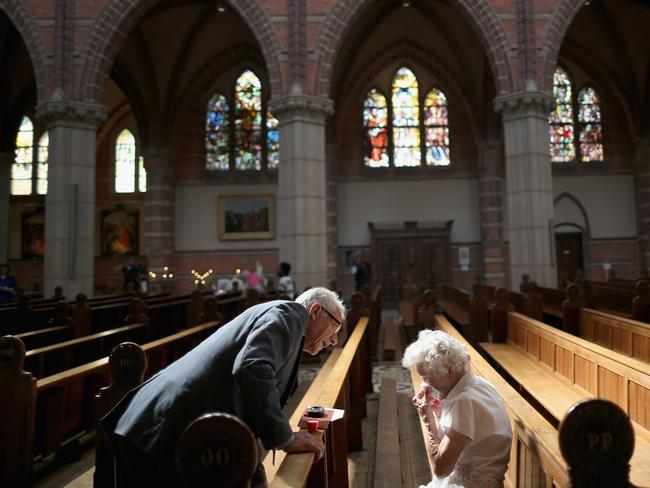 Locals attend a special mass in Saint Vitus Church in memory of the victims of Malaysia Airlines flight MH17 on July 20, 2014 in Hilversum, Netherlands. Three families from Hilversum were killed in the crash. Picture: Christopher Furlong.