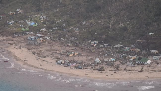 Giant waves inundated low lying costal areas, causing widespread damage. Picture: NZ Defence AirForce/Fijian Government