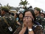 A typhoon survivor cries after being denied boarding a C-130 military transport plane in Tacloban city, Leyte province, central Philippines. Picture: AP