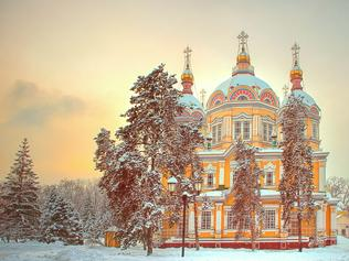 Russian Orthodox cathedral located in Panfilov Park in Almaty, Kazakhstan on sundown. Completed in 1907, it is the second tallest wooden building in the world.