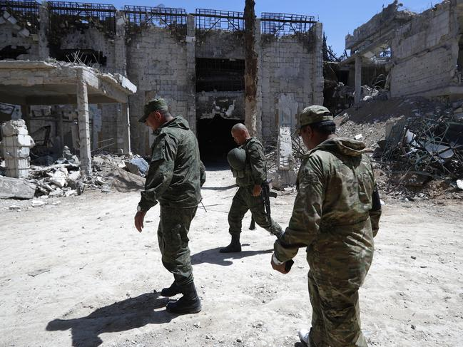 Russian military police officers patrol in the town of Douma, the site of a suspected chemical weapons attack, near Damascus, Syria. Picture: AP