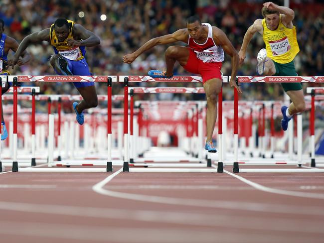 Nick Hough (R) competes in the final of the men's 110m hurdles.
