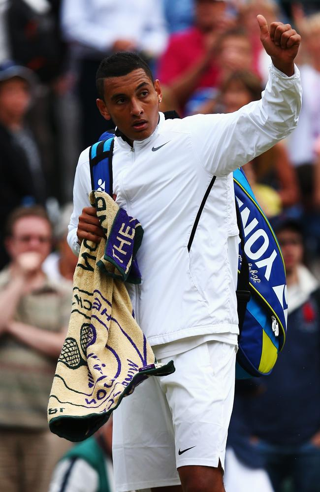 Nick Kyrgios acknowledges the fans as he walks after losing his Gentlemen's Singles quarter-final match.