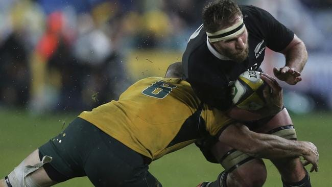 All Blacks No. 8 Kieran Read is brought down by Wallabies flanker Scott Fardy.