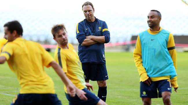 Holger Osieck watches his team during a light training session at ANZ Stadium Homebush in preparation for the upcoming World Cup qualifier against Oman.