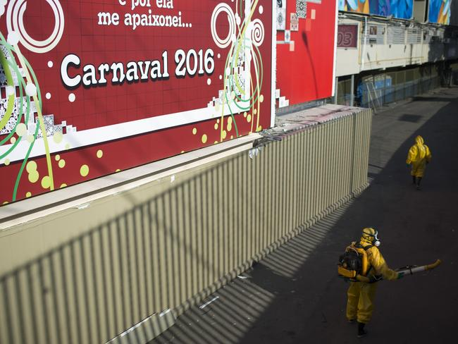 Losing battle ... Inspectors disinfect the area around the famous Sambadrome, in an effort to protect next month's Carnival parades Zika-carrying mosquitoes. Picture: AP Photo/Leo Correa