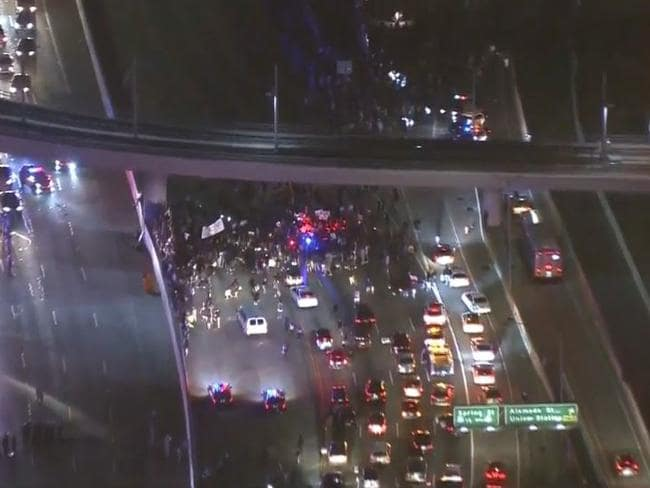 Anti-Donald Trump protesters shut down the 101 freeway in Los Angeles. Picture: CBS12.com