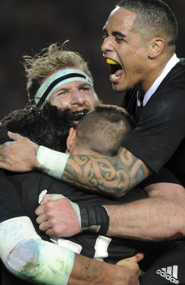 All Black players celebrate their big win over the Wallabies.