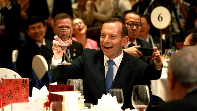 Who does he support ... Tony Abbott at a lunch with Chinese Vice Premier Wang Yang in Beijing, China.