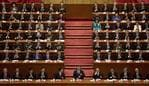 "Chinese President Xi Jinping, center, sits with former Chinese President Hu Jintao, fifth left, and Jiang Zemin, fifth right, after delivering his speech at the opening ceremony of the 19th Party Congress held at the Great Hall of the People in Beijing, China, Wednesday, Oct. 18, 2017. Xi on Wednesday urged a reinvigorated Communist Party to take on a more forceful role in society and economic development to better address ""grim"" challenges facing the country as he opened a twice-a-decade national congress. (AP Photo/Ng Han Guan)"
