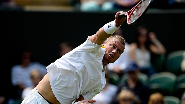 South Australian veteran Lleyton Hewitt serves to stay in the match against Dustin Brown.