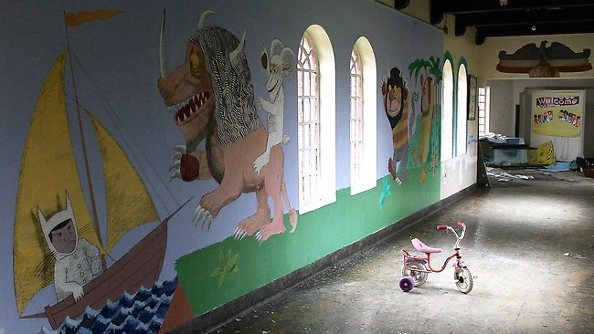 Mural painted on the wall in a children's ward of a disused New York asylum. Photo: Julia Wertz.