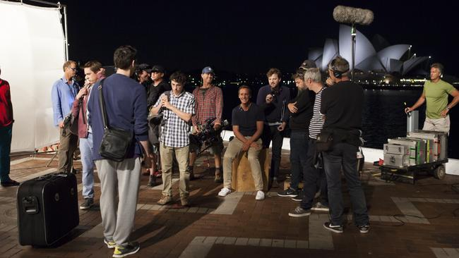 Action ... The Inbetweeners 2 cast and crew discuss the scene with the Sydney Opera House as their backdrop.