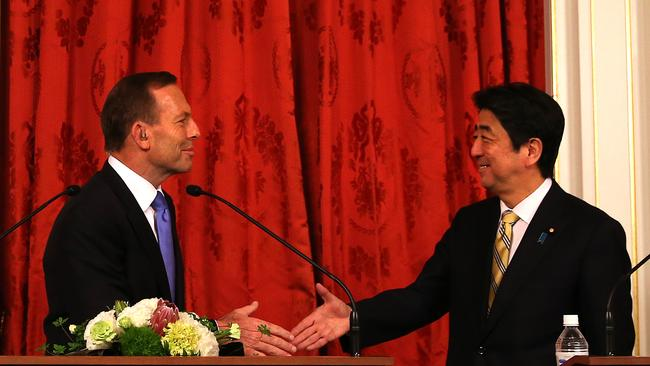 Working together ... Prime Minister Tony Abbott with Japanese PM Shinzo Abe during his April visit to Tokyo.